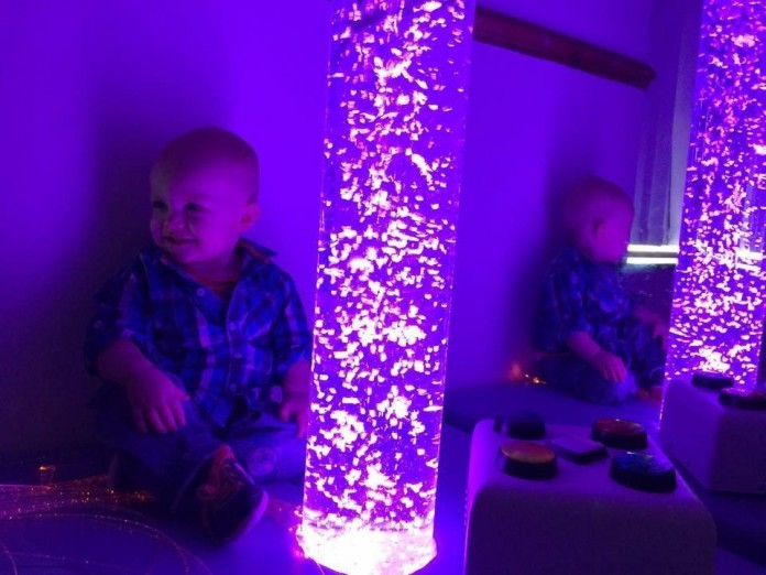 Picture of small child in Sensory World bubble tube room