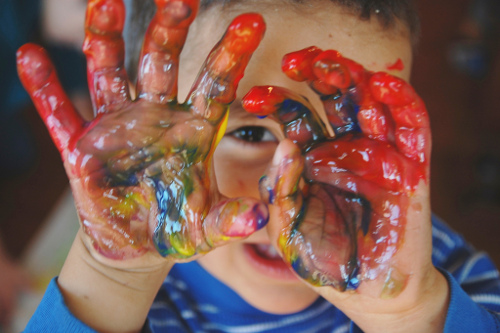 photo of child with painty hands